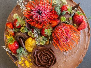 Chocolate torte with chocolate filling and native blooms