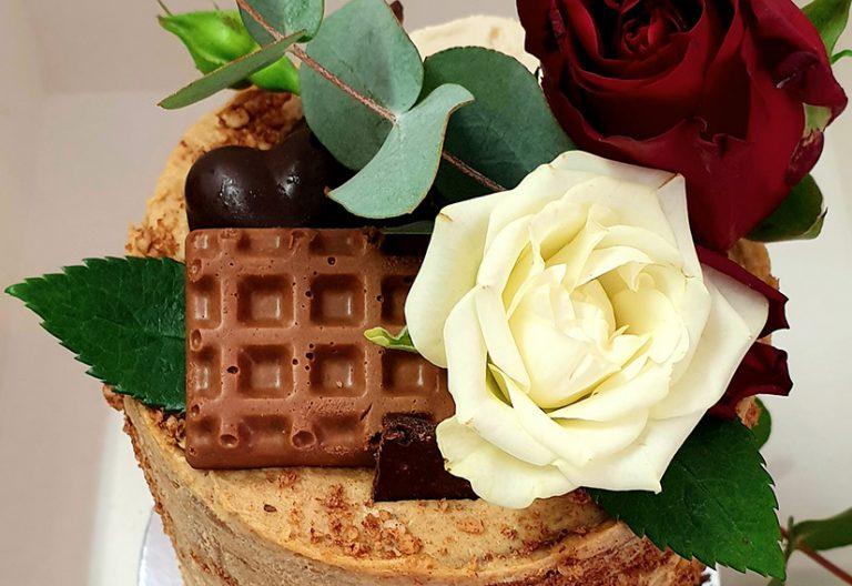 Tall mini chocolate caramel cake with roses
