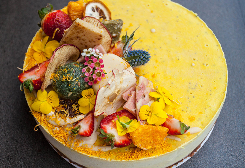 Tropical cheesecake with mango pineapple and passion fruit